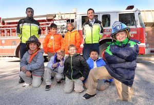 Firefighters in Baltimore give new coats to kids in need